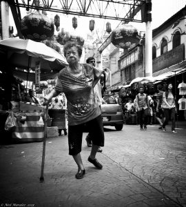 """A woman walks with the support of a cane in Kuala Lumpar, Malaysia. Photo """"Just Walk This Way"""" by Neil Moralee, CCBY via Flickr"""