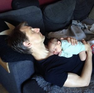 Me and my daughter taking a nap during parental leave. Photo credit: Ida Knutsson