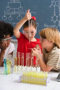 Young students gain first-hand knowledge of basic chemical principles.