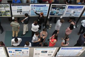 Witness scicomm in action, from the poster session of 2014 summer internship program hosted by NASA's Goddard Space Flight Center. Photo courtesy of Goddard Studio via Flickr (CC BY).