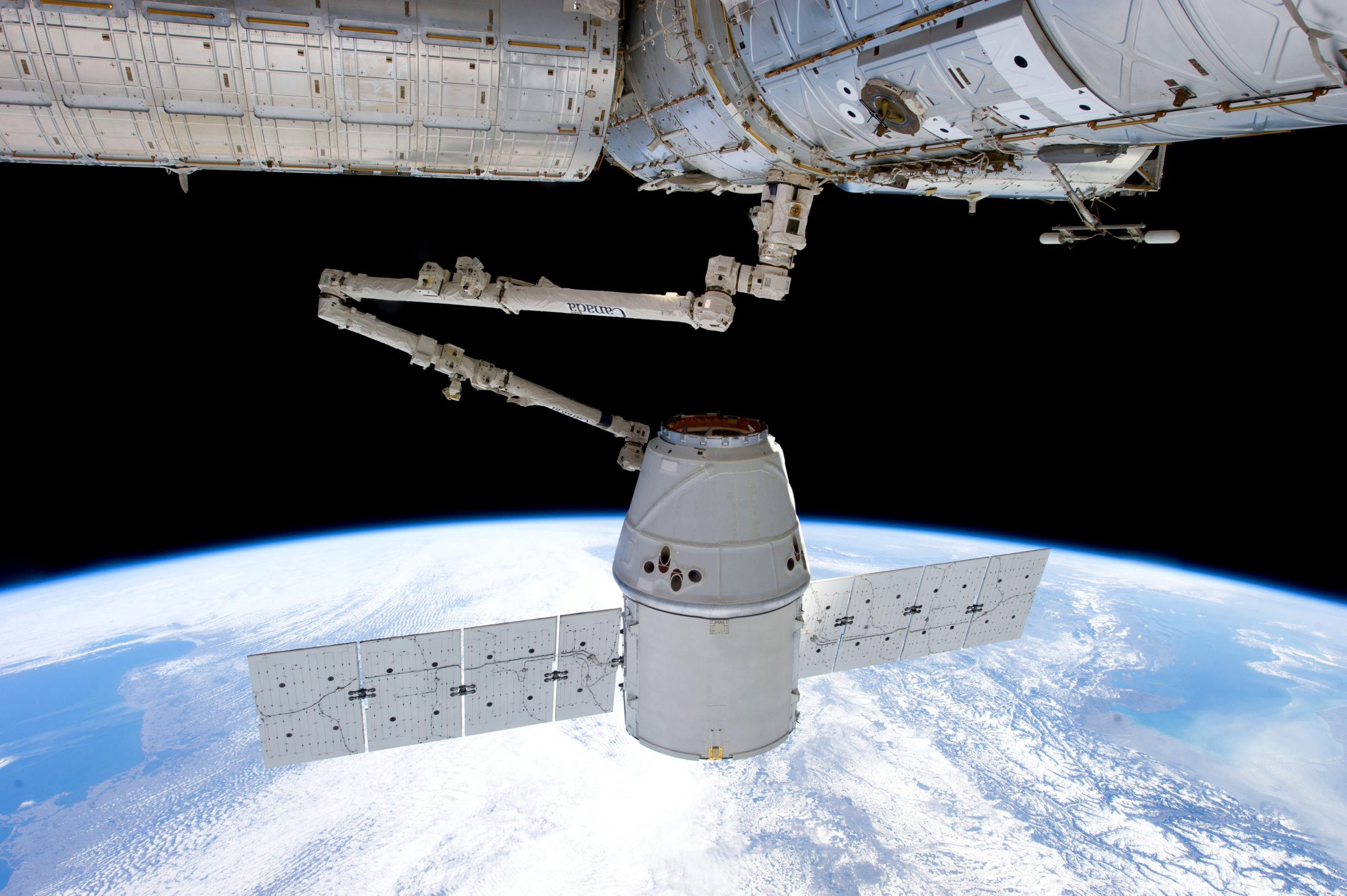 International Space Station fastening onto Dragon. (Image Credit: SpaceX)