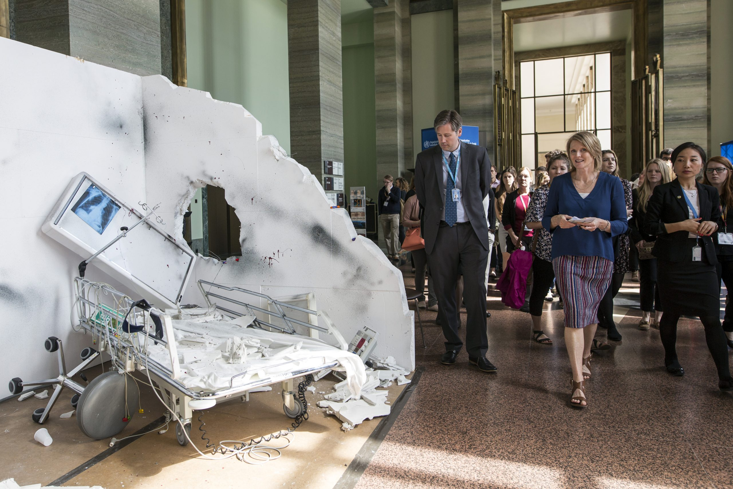 Installations and exhibits illustrating WHO's work are featured each year at the World Health Assembly. This installation depicts attacks on health-care centres and health workers.Photo Credit: WHO/L. Cipriani